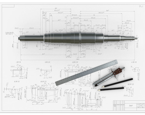metal shaft, compasses, rulers and pencils at an engineering drawing